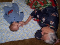 She loved to get in the floor and play with her grand babies.