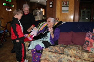 Trey teaching mamaw to play his guitar.